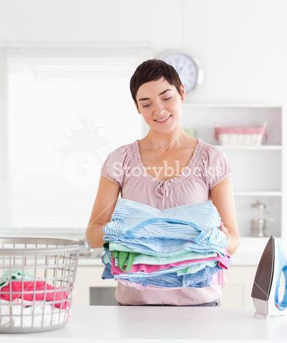 Smiling Woman with a pile of clothes