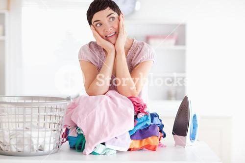Cheerful Woman with a pile of clothes