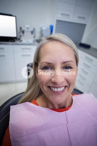 Female patient sitting on dentist chair