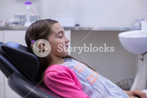 Young patient sitting on dentists chair