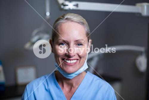 Dental assistant smiling in clinic