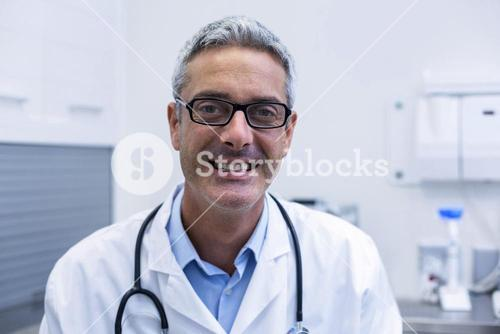 Portrait of dentist in spectacles