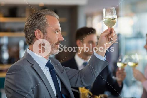 Portrait of businessman toasting his beer glass