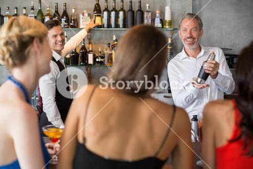 Female friends ordering drinks