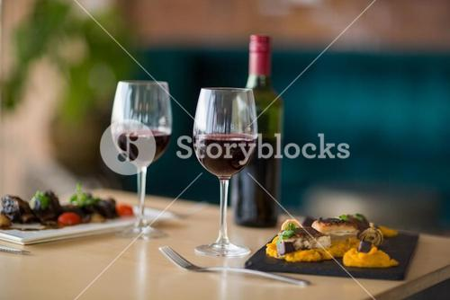 Plate of meal with glass of red wine