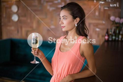 Beautiful woman holding a champagne flute