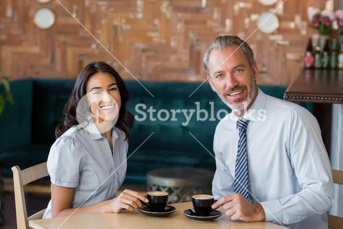 Man and woman meeting over coffee in restaurant
