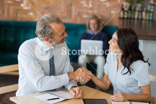 Business colleagues shaking hands after a successful meeting