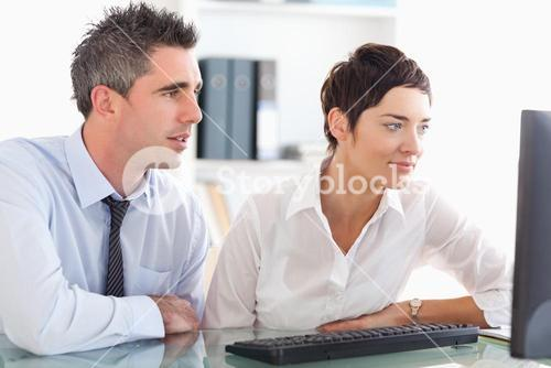 Colleagues working with a computer