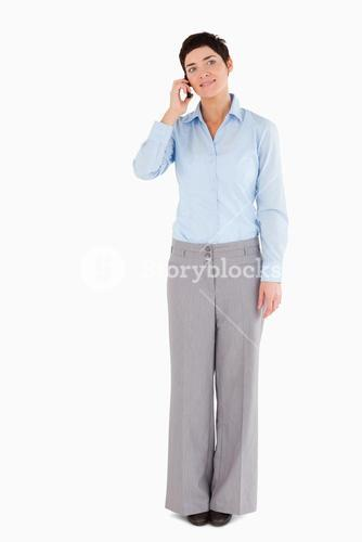 Serious woman making a phone call