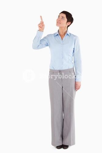 Businesswoman pointing at copy space