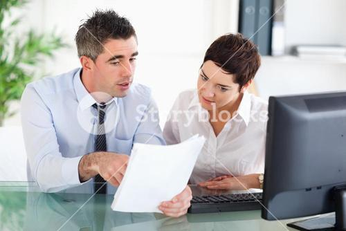 Office workers looking at a document