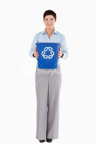 Businesswoman showing a recycling bin