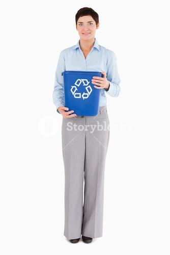 Businesswoman with a recycling bin