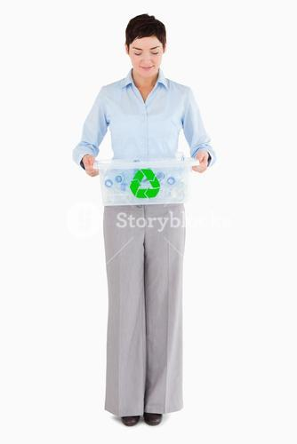 Businesswoman with a recycling box