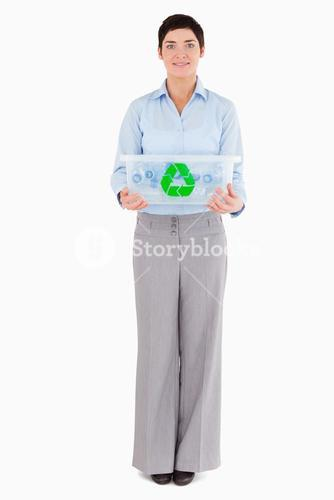 Businesswoman showing a recycling box