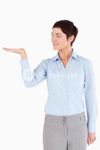 Businesswoman with an open hand to show a copy space