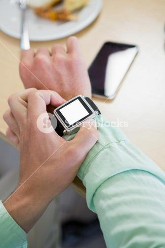 Man adjusting time on his smartwatch