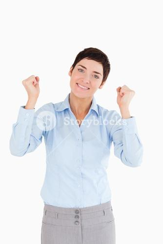 Smiling businesswoman with the fists up