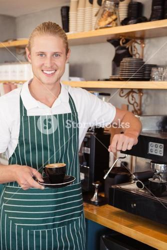 Waiter holding a cup of coffee