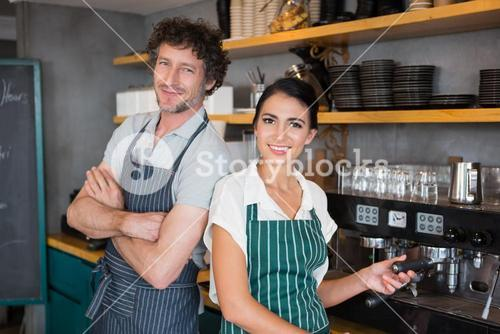 Waiter and waitress in cafeteria