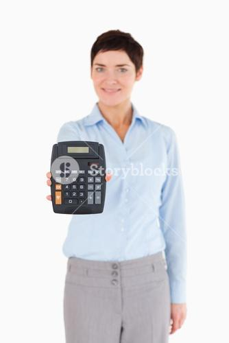 Female office worker showing a calculator