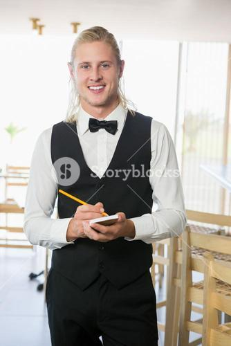 Waiter writing order on notepad
