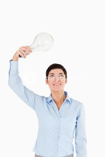 Businesswoman holding a light bulb