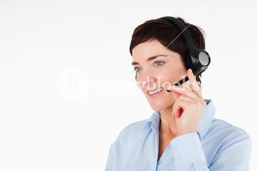 Close up of a office worker using a headset