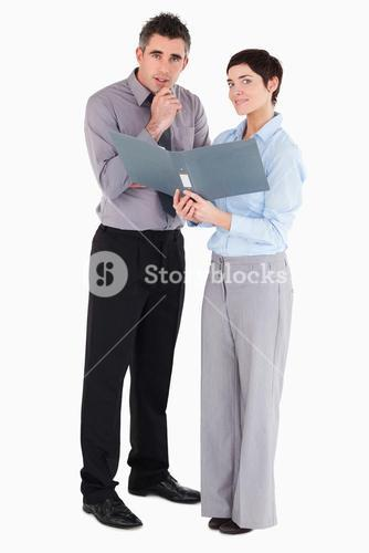Office workers holding a binder