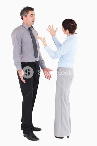Office workers arguing