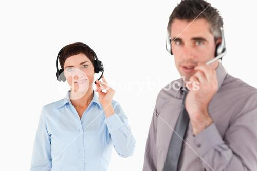 Office workers using headsets