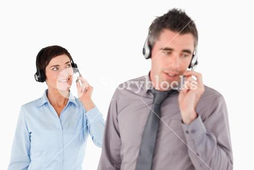 Business people using headsets