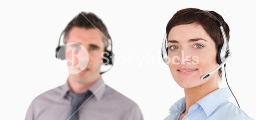 Close up of managers using headsets
