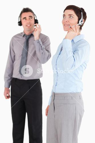 Portrait of managers using headsets