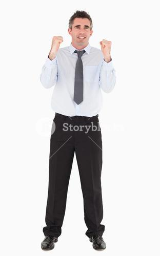 Cheerful businessman with the fists up