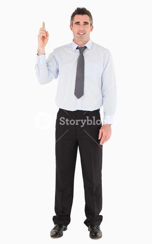 Businessman pointing at copy space
