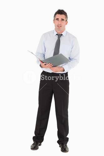Businessman holding a binder