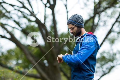 Hiker checking time on wristwatch