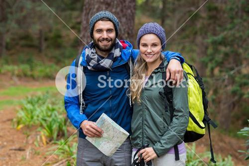 Portrait of hiker couple standing at countryside