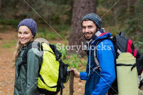 Portrait of hiker couple hiking in forest