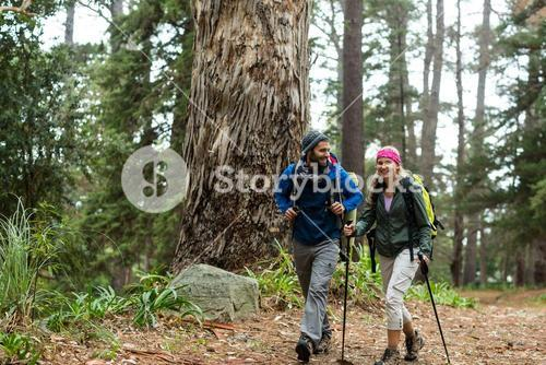 Hiker couple hiking in forest