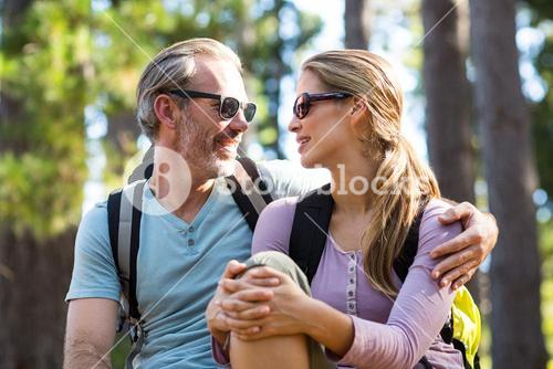 Smiling couple looking face to face while relaxing