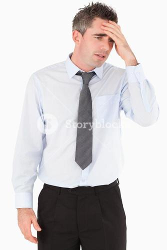 Portrait of a sad businessman with his hand on his forehead