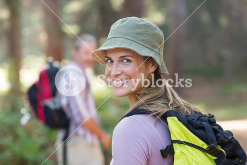 Portrait of hiker hiking in forest