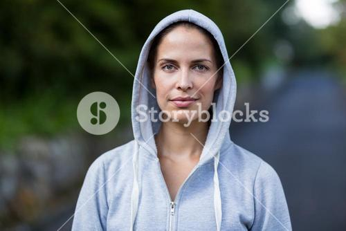 Confident woman wearing hooded sweater