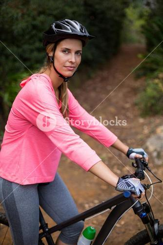 Woman cycling on the road