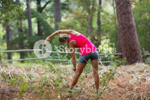 Woman exercising in forest