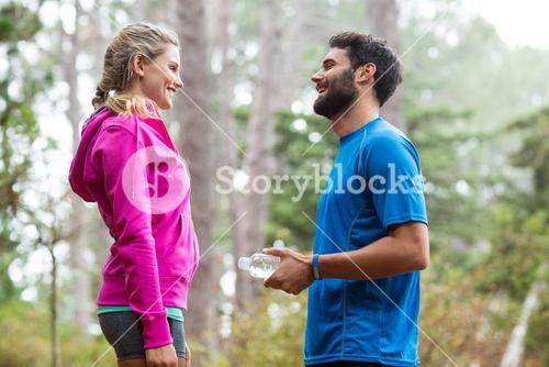 Athletic couple interacting with each other