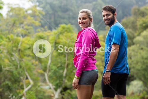 Couple standing in forest